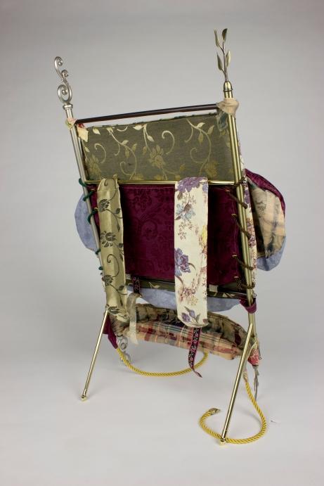 "Found fabrics, found curtain rods, mixed media; 28"" x 17"" x 14"""
