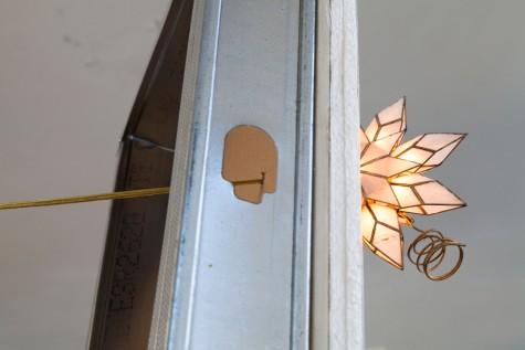 Shows rewiring of star through drywall