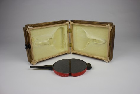 Omelet pan, stained plywood and molding, two-part expending foam, charcoal foam, hardware; dimensions variable when open