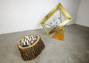 In Between Times; 2016; found stump; found fireplace facad; reused computer fans; firest hunting print; electric tea candles; steel; mixed media; dimensions variable